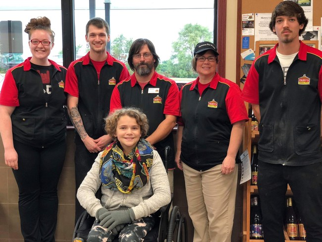 MDA Ambassador Natalie from Cedar Falls, Iowa with members of the Casey's team.